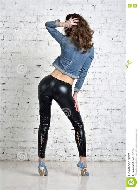 Beautiful Girl With Big Booty In The Pants Of Latex Stock