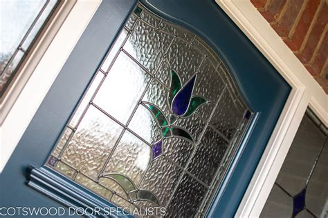 stained glass front door painted blue cotswood doors