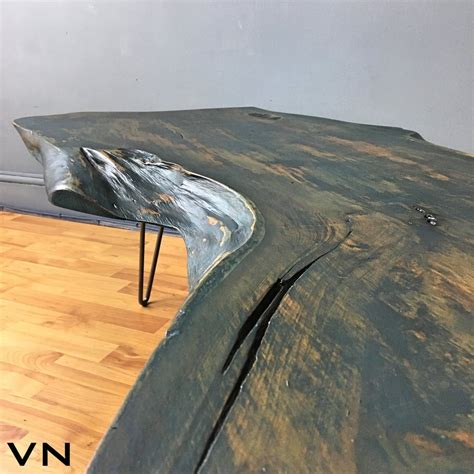 Live edge wood is a style of furniture or fixtures that incorporates the natural edge of the wood into the design of the piece. Live edge wood slab coffee table on industrial hairpin ...
