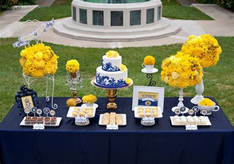 blue and yellow decorations grad wedding flower and blue desserts