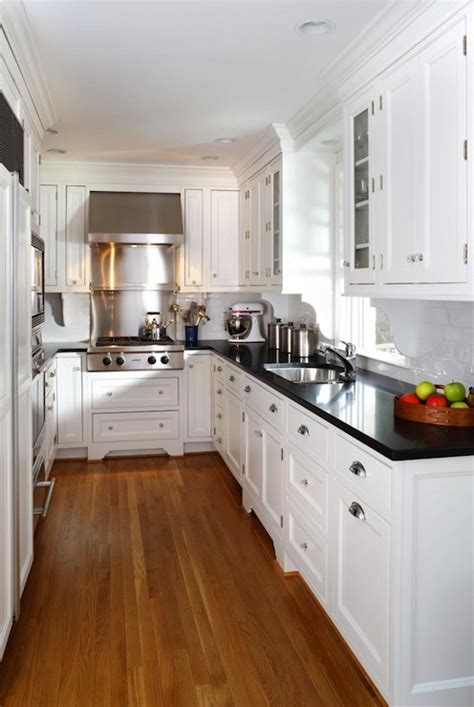 kitchen with white cabinets and black countertops white kitchen cabinets with black countertops