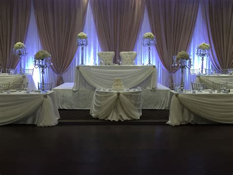 chagne and ivory backdrop 5 tier head table made for