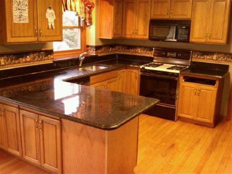 honey oak kitchen cabinets with granite countertops honey oak kitchen cabinets with black countertops