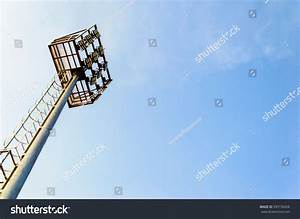 Stadium light pole on blue sky stock photo