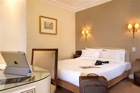 chambre blanche et beige hôtel 4 étoiles louvre hotel concorde hotel 1
