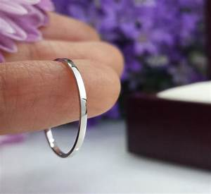 handmade super thin platinum wedding band fortified With spacer between engagement ring and wedding band