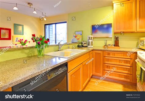 yellow green kitchen happy kitchen with tulips and yellow green walls 1210