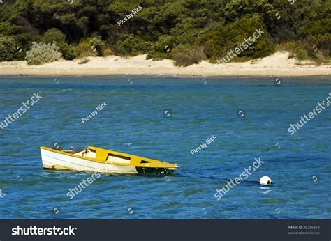 Small Yellow Boat by A Small Yellow Boat To A Mooring Is Slowly Sinking