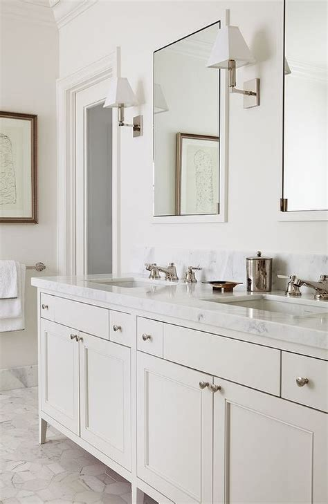 chic master bath features  cream double vanity topped