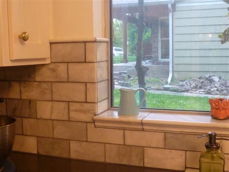 kitchen window backsplash showing the tile around window and top of wall tiles