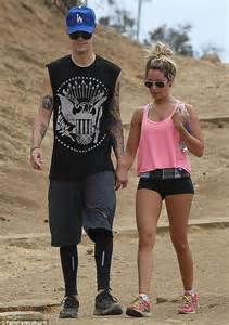 Ashley Tisdale beats the heat in tiny shorts as she enjoys ...