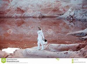 Futuristic Astronaut On Another Planet, Image With Stock ...