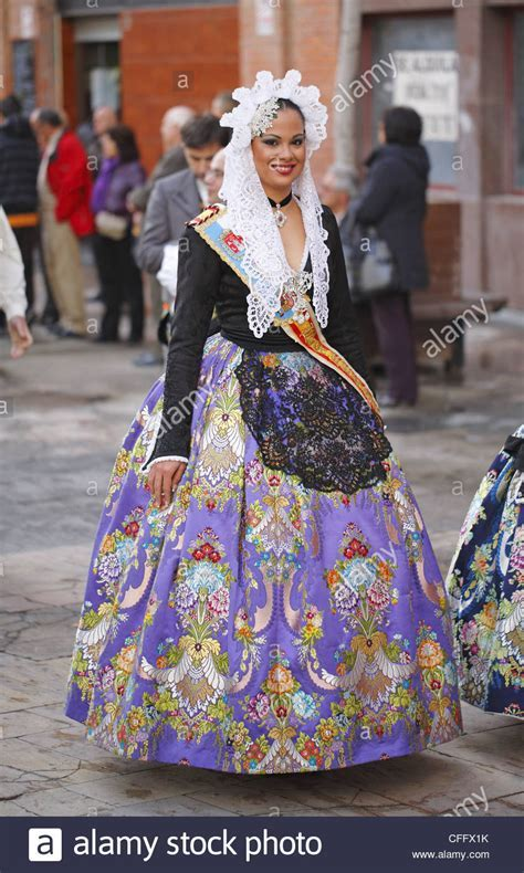 Spanish woman wearing traditional dress during the street