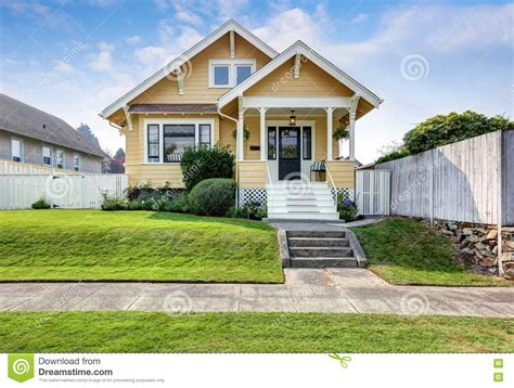 American Craftsman Home With Yellow Exterior Paint Stock