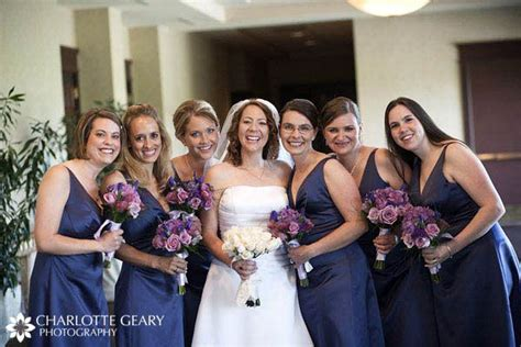 Bridesmaids In Navy Blue Dresses With Purple And Blue