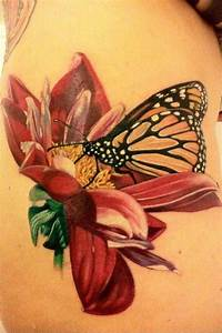 A beautiful butterfly and flower tattoo based on a ...