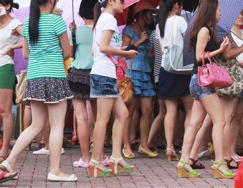 Chinese Girls Line Up For The Miniskirt Discount At A