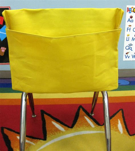 1 small yellow classroom chair pockets seat sacks desk