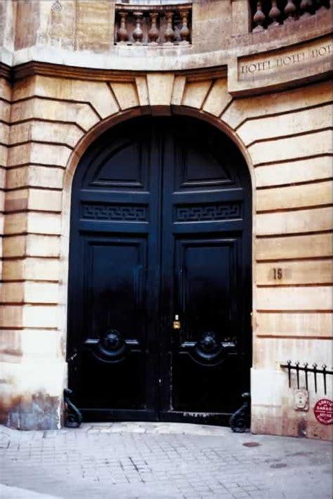 concave stone wall  arch  huge blue double doors door  window