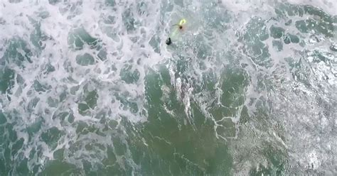 drone distress rescue swimmers save anith
