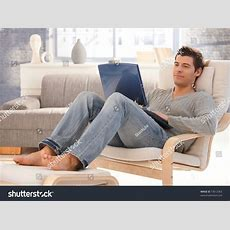 Goodlooking Young Man Relaxing Home Armchair Stock Photo
