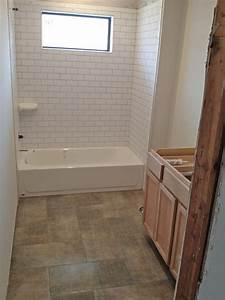 12x24 porcelain tile in herringbone layout bathroom With 12x24 tiles in bathroom