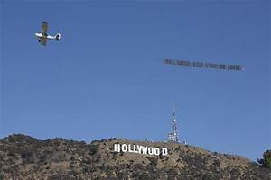 Banner seen over Los Angeles demands Hollywood 'stop ...