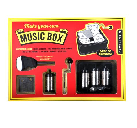 The music box movement attached a metal punch and 20 paper strip to make any song you want. Make Your Own Music Box Set | Pink Cat Shop