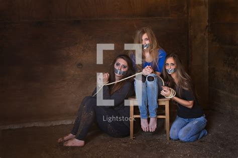 Teen Girls Duct Taped Bound Ropes Photo Lightstock