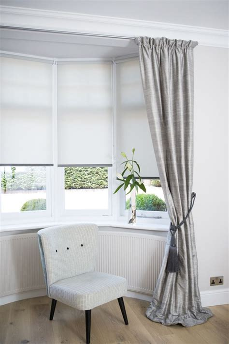 Window Blinds And Curtains dressing a bay window by combining curtains and roller