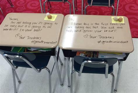 teacher turns student desks  notes  encouragement