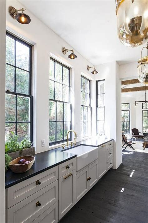 white kitchen cabinets  black  gold hardware