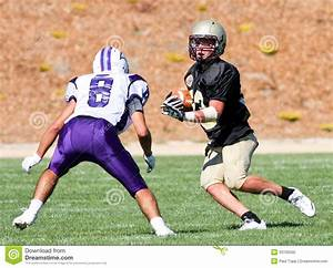 High School Football Player Running With The Ball During A ...