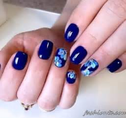 Another flora inspired dark blue nail art design the background