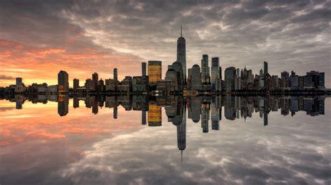 manhattan skyline   populated  york city sunnset