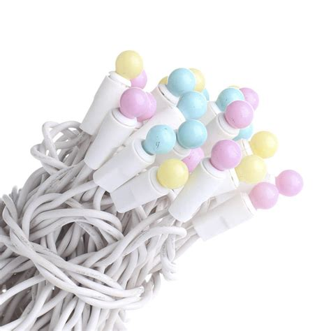 pastel globe bulb and white cord string lights lighting