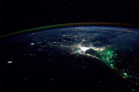 what are these mysterious green lights photographed from the space station universe today