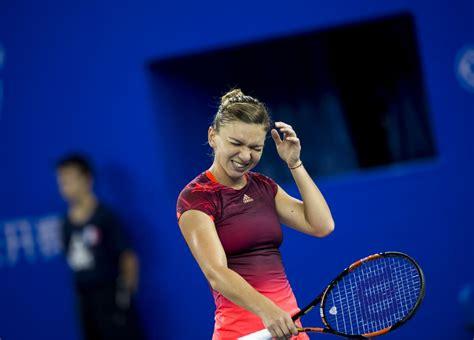Caroline Wozniacki thrashes Simona Halep to advance at WTA Finals | Sport | The Guardian