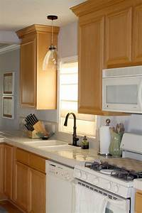 Fancy pendant light over kitchen sink the