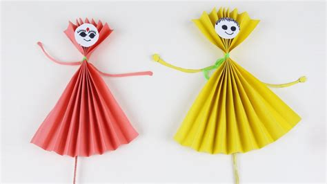 origami red  yellow paper dolls    paper