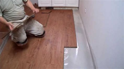 installing laminate flooring on concrete how to install laminate flooring on concrete in the kitchen mryoucandoityourself youtube