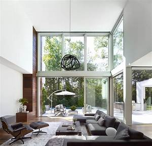 Spacious, Double, Height, Modern, Living, Room, Opening, Up, To, A, Patio, By, The, Pool, In, A, Wooded