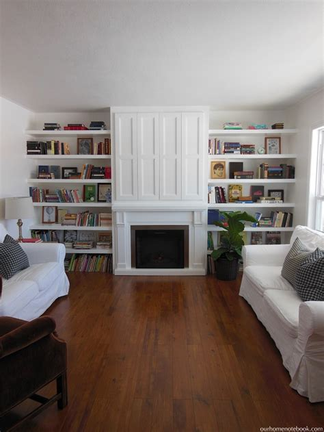 remodelaholic built  fireplace surround  shelving