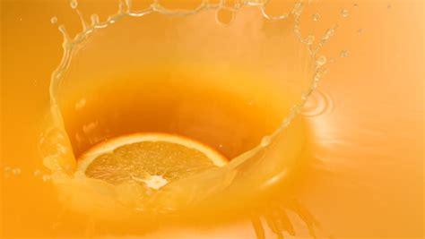 1080p Orange Fruit Wallpaper Hd by Stock Clip Of Sliced Orange Falling Into Orange