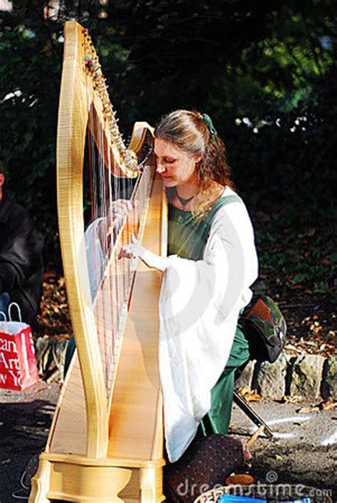 beautiful girl playing harp editorial stock photo image