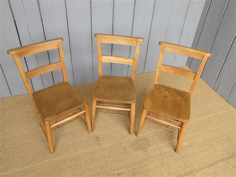 17 available antique church chairs without book holders
