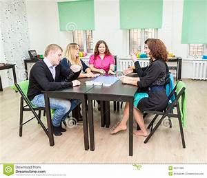 Group Of Young People Sitting At Table And Playing Games ...
