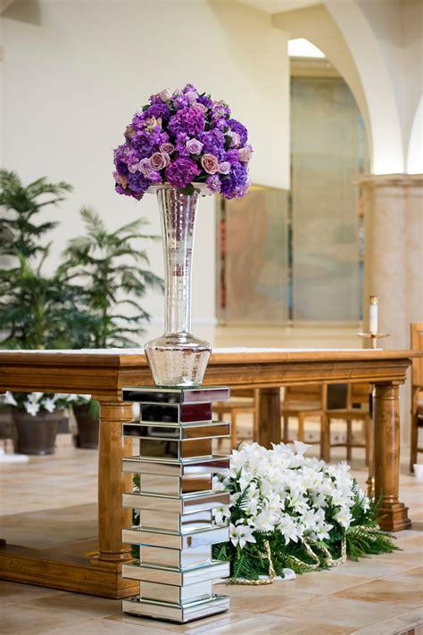 tall purple flower arrangements mirror pillars