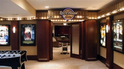 The Entrance Of A Cinema Hotel Or Theatre by This Ultimate Rec Room Home Theater Has The Feel Of