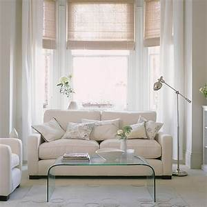 White living room with clear furniture White living room